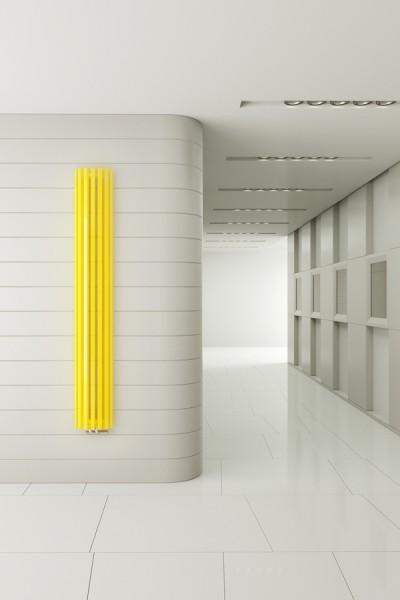 Designheizkörper Triga AN in Gelb auf weißer Wand